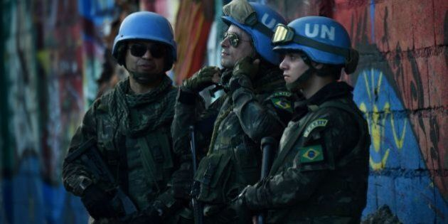 Brazilian military members from United Nations Stabilization Mission in Haiti (MINUSTAH) stand guard...