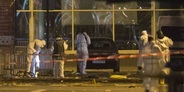 PARIS, FRANCE - NOVEMBER 13: French police forensic examiners investigate the scene outside the Stade...