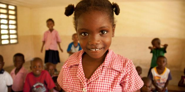 Young female 5-7 in Haiti smiling in her