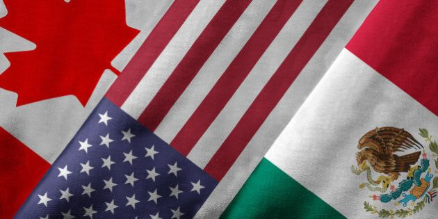 Closeup of the flags of the North American Free Trade Agreement NAFTA members on textile texture. NAFTA...