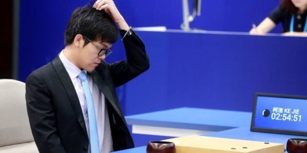 China's 19-year-old Go player Ke Jie reacts during the first match against Google's artificial intelligence...