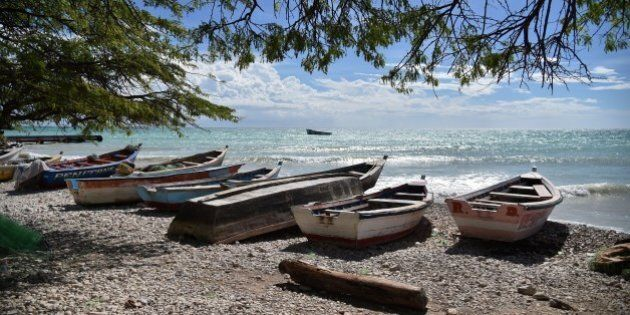Boats are stored on a beach in the commune of is Anse-a-Pitres, in the South East Department of Haiti,...