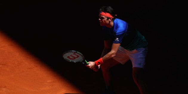 MADRID, SPAIN - MAY 02: Milos Raonic of Canada prepares to receive a serve against Thomaz Bellucci of...