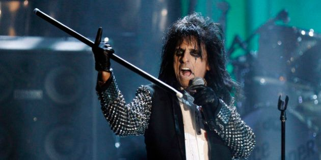 Singer Alice Cooper performs after being inducted during the 2011 Rock and Roll Hall of Fame induction...