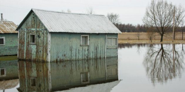 old barn in flooded water