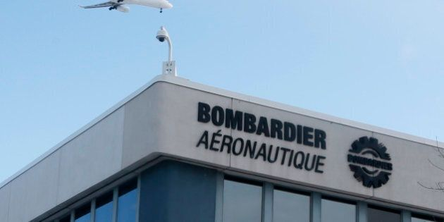 A plane flies over a Bombardier plant in Montreal, Quebec, Canada on January 21, 2014.   REUTERS/Christinne Muschi/File Photo