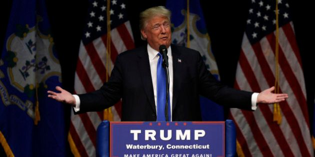 Republican presidential candidate Donald Trump during a campaign event at Crosby High School in Waterbury, Conn., Saturday, April 23, 2016. (AP Photo/Charles Krupa)