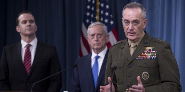 US Secretary of Defense Jim Mattis (C), Chairman of the Joint Chiefs of Staff Marine General Joseph Dunford...