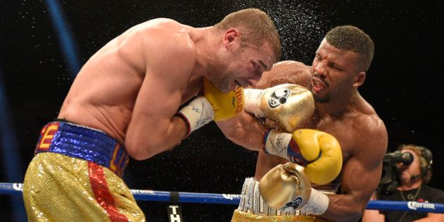 Badou Jack, right, fights Lucian Bute during a boxing match early Sunday, May 1, 2016, in Washington....