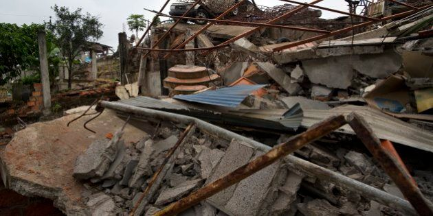 A car sits on top of an earthquake-destroyed home one week after the devastating quake in Pedernales,...