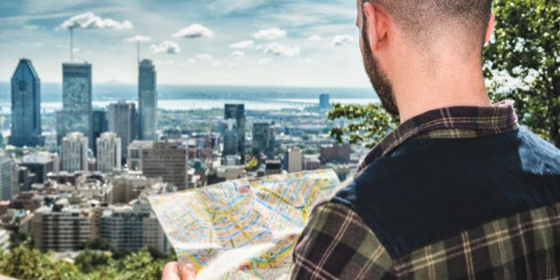 tourist reading a map in