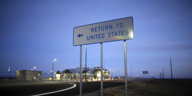 A United States border post into Canada is seen before it opens in the morning near Havre, Montana, United...