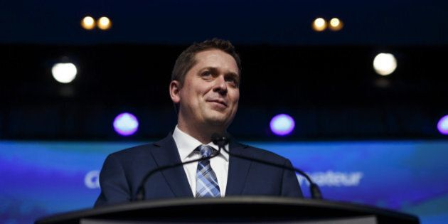Andrew Scheer, leader of Canada's Conservative Party, smiles while speaking after being named the party's...