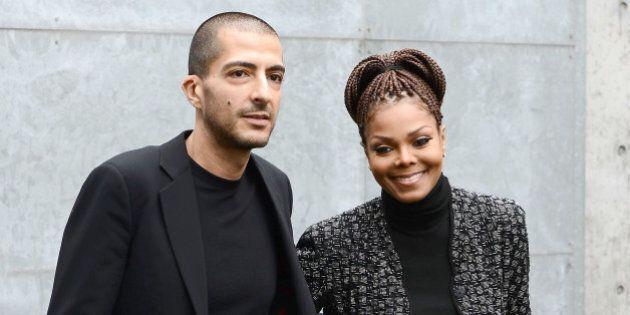 MILAN, ITALY - FEBRUARY 25: Wissam al Mana and Janet Jackson attend the Giorgio Armani fashion show during...