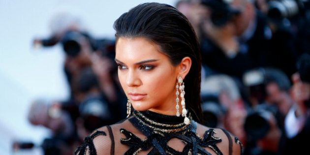 Model Kendall Jenner poses on the red carpet as she arrives for the screening of the