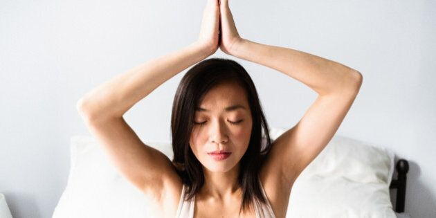 asian woman doing yoga in the