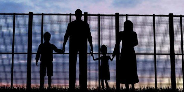 Silhouette of a refugees family with