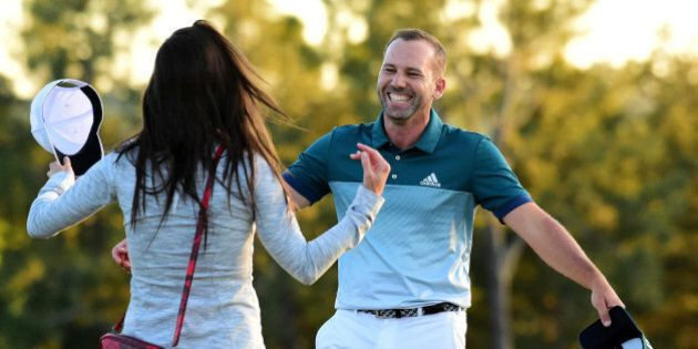 AUGUSTA, GA - APRIL 09: Sergio Garcia of Spain embraces fiancee Angela Akins in celebration after defeating...