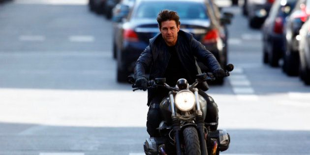 Actor Tom Cruise is seen riding a BMW bike on the set of 'Mission Impossible 6 Gemini' on Avenue de l'Opera...