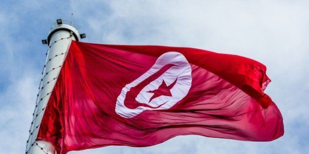 TUNIS, TUNISIA - MARCH 20: A Tunisian flag is raised up to the highest flagpole with 60 meters height...