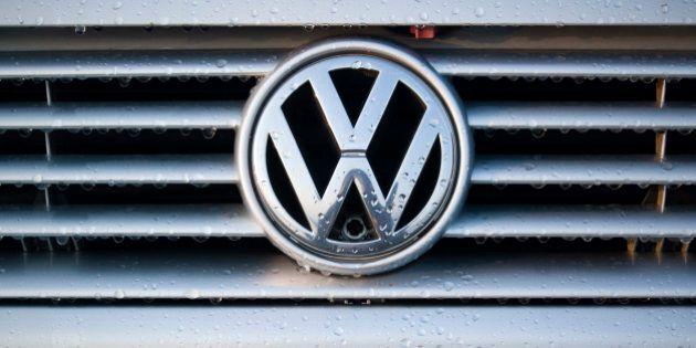 'Padua, Italy - July 6, 2011: Wet Volkswagen metallic logo on a car hood. Volkswagen is a German, world...