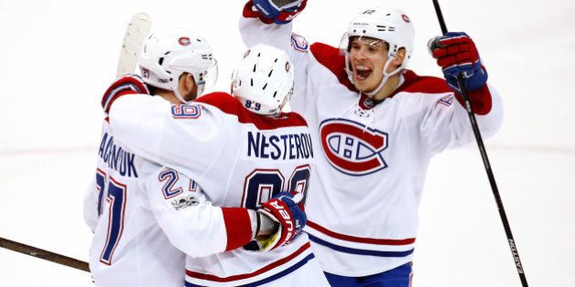 DETROIT, MI - APRIL 08: Alex Galchenyuk #27 of the Montreal Canadiens celebrates his overtime goal with...