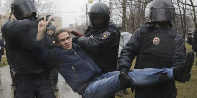 Interior Ministry officers detain a participant of an opposition protest, calling for Russian President...