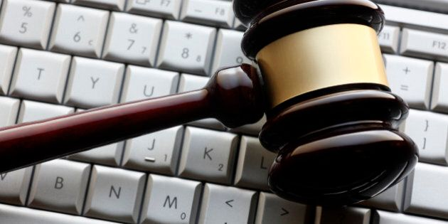 A gavel on a computer keyboard representing an internet auction or computer related