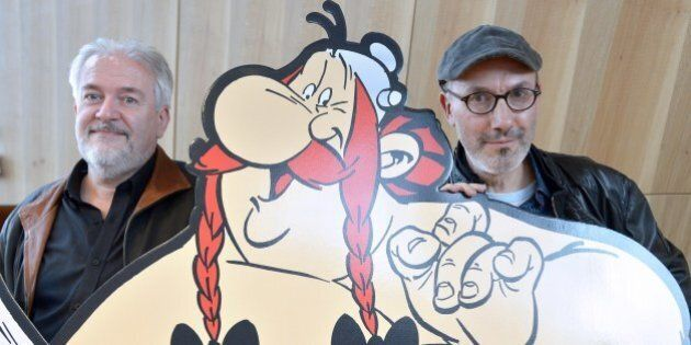 French cartoonist Didier Conrad (L), and the coauthor of the popular comic book Asterix with French cartoonist...