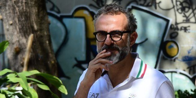 Italian chef Massimo Bottura walks in Rio de Janeiro, as the Rio 2016 Olympic Games are being held in Brazil, on August 9, 2016.Restaurant-goers usually pay hundreds of euros to eat the creations of Massimo Bottura, but during the Olympics he is serving up scraps to poor Brazilians for free. Bottura's ingredients are garbage-bound surplus food donated by the catering companies at the Olympic park and athletes' village. / AFP / TASSO MARCELO        (Photo credit should read TASSO MARCELO/AFP/Getty Images)
