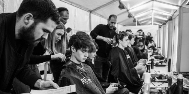 PARIS, FRANCE - JANUARY 19: (EDITORS NOTE : Image has been processed with digital filters.) Models prepare...