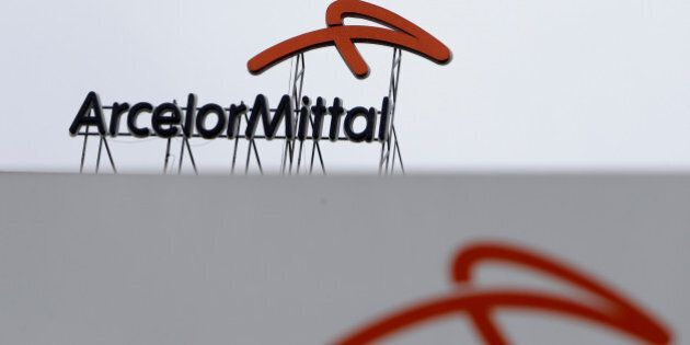 A logo is seen on the roof of the ArcelorMittal steelworks headquarters in Ostrava, Czech Republic, April...