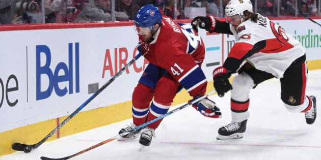 MONTREAL, QC - MARCH 25: Paul Byron #41of the Montreal Canadiens controls the puck while being challenged...