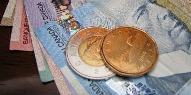 Canadian currency ranging from $1 (loonie) and $2 (toonie) coins, to $5, $10, $20, $50, and $100