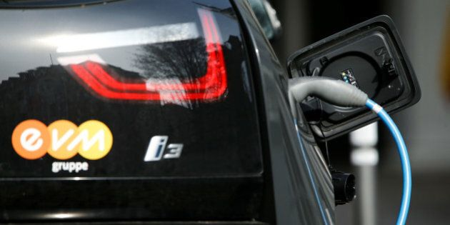 FILE PHOTO - A BMW i-3 electrical car is refueled at a power station for e-cars in the city centre of...