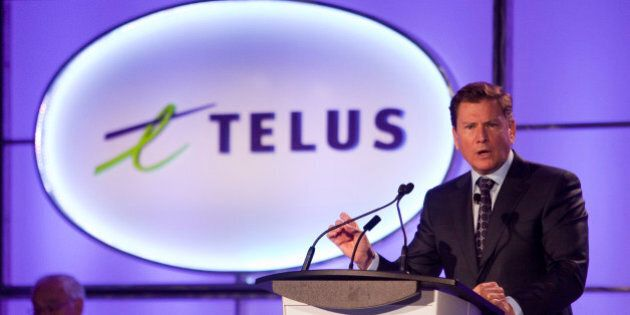 Former Telus CEO Darren Entwistle speaks at the annual general meeting in Vancouver, British Columbia May 8, 2014. Entwistle, who is being replaced by Joe Natale, will stay on as executive chair of the board. REUTERS/Ben Nelms (CANADA - Tags: BUSINESS TELECOMS)