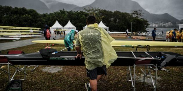 A New Zealand's technical staff member prepares a boat for a training session at the Lagoa stadium following...
