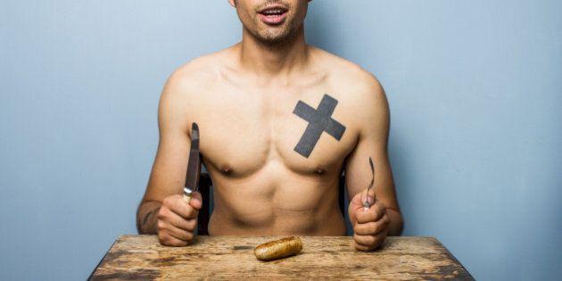 Naked man posing with his sausage