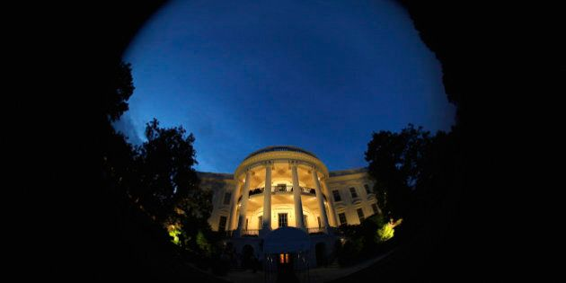 The White House is illuminated at night as U.S. President Barack Obama (not pictured) and his family...