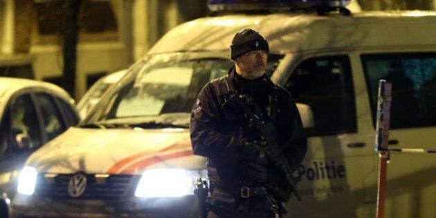 BRUSSELS, BELGIUM - JANUARY 14: A police officer stands guard during searches at Molenbeek district as...