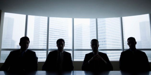 Silhouette row of businessmen sitting in meeting