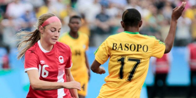 Janine Beckie (L) of Canada vies for the ball with Kudakwashe Basopo of Zimbabwe during their Rio 2016...