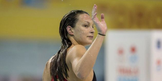 TORONTO, ON - APRIL 7 - Penny Oleksiak waves to supports after competing in the Women 200 Metre Freestyle...