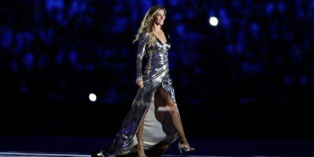RIO DE JANEIRO, BRAZIL - AUGUST 05: Supermodel Gisele Bundchen walks as The Girl From Ipanema during...