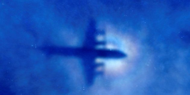 FILE PHOTO: The shadow of a Royal New Zealand Air Force (RNZAF) P3 Orion maritime search aircraft can...