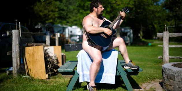 A man plays a guitar at the Bare Oaks Family Naturist park in Sharon June 18, 2011. The International...