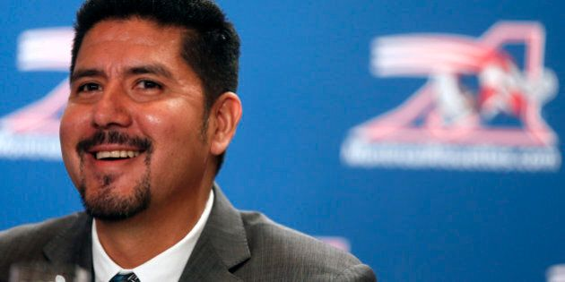 Montreal Alouettes quarterback Anthony Calvillo laughs with the media after he announced his retirement...
