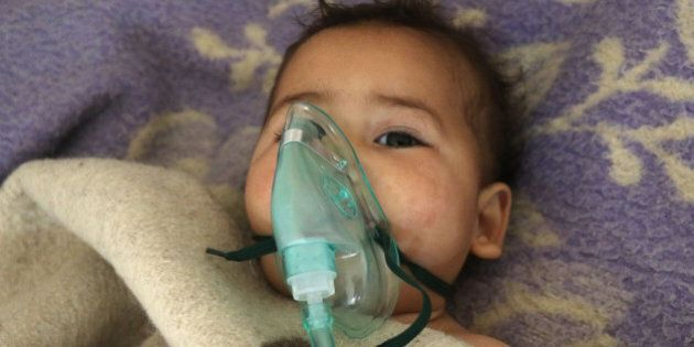 A Syrian child receives treatment following a suspected toxic gas attack in Khan Sheikhun, a rebel-held...