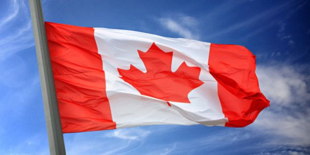 The Canadian flag against the blue