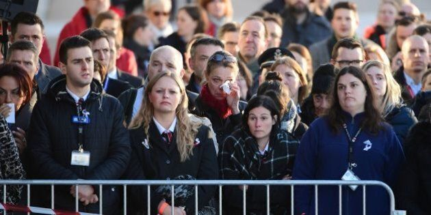 Employees at Brussels' international airport in Zaventem gather for a memorial ceremony to mark the first anniversary of the twin Brussels attacks by Islamic extremists on March 22, 2017.Belgium marks the first anniversary of the Islamic State bombings in Brussels, one at the airport and the other in the metro, in which 32 people were killed and more than 320 wounded with ceremonies showing that the heart of Europe stands defiant. / AFP PHOTO / BELGA AND AFP PHOTO / Emmanuel DUNAND        (Photo credit should read EMMANUEL DUNAND/AFP/Getty Images)